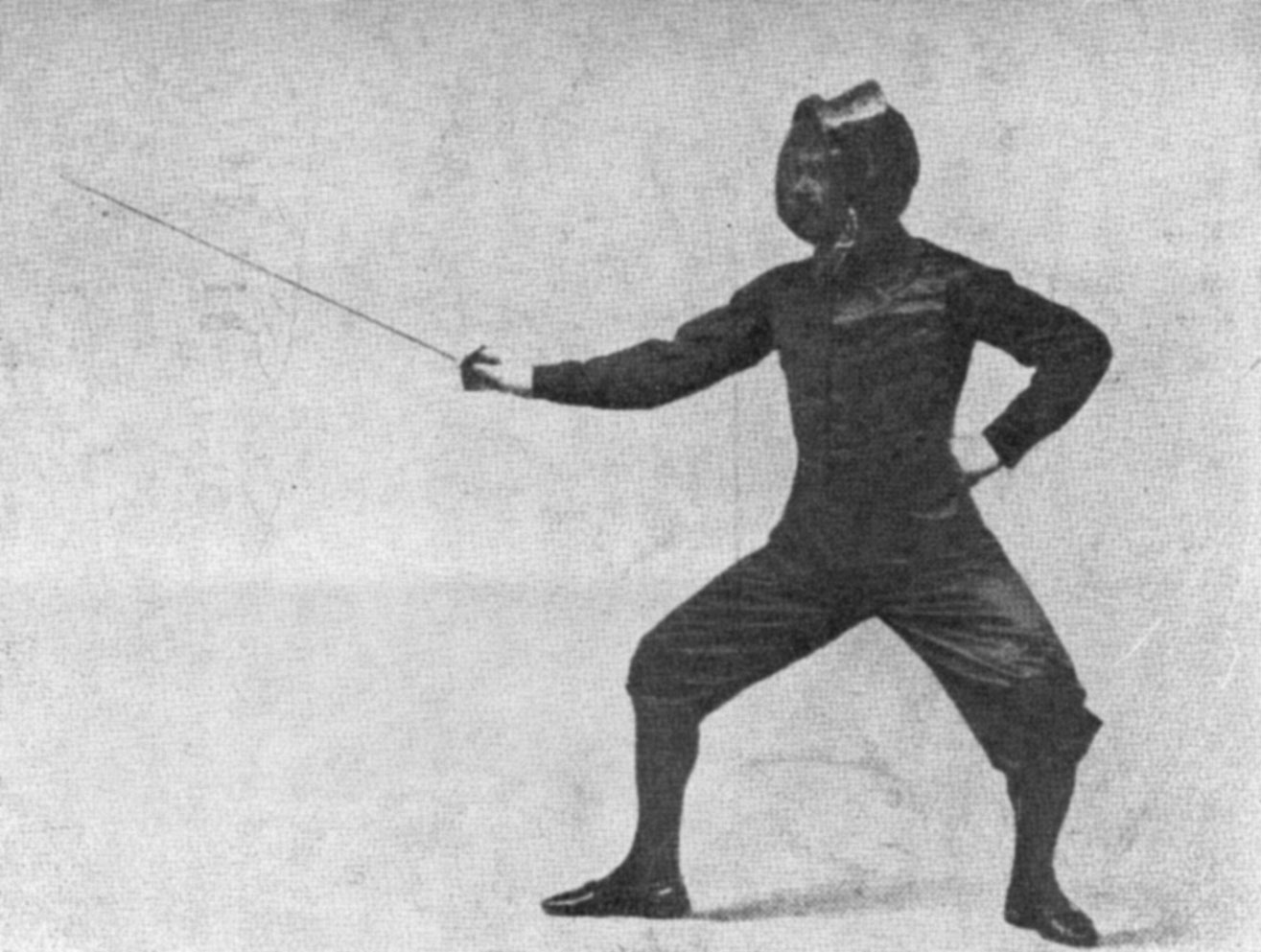 Person fencing with mask on