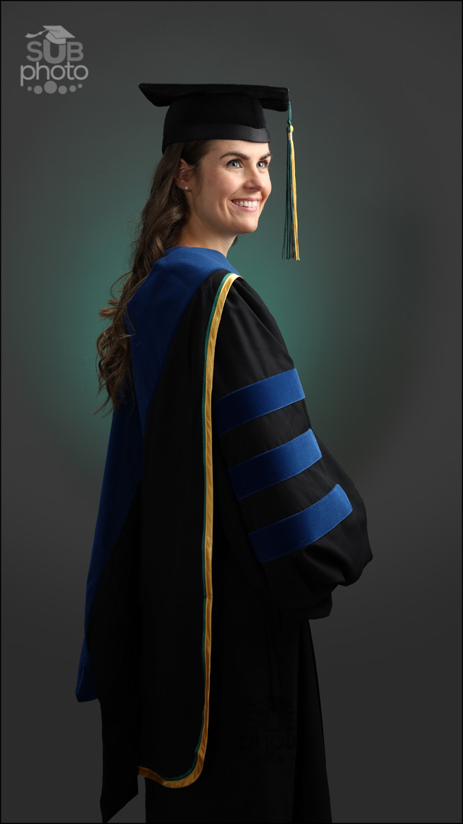 Woman wearing University of Alberta Doctorate cap and gown PhD