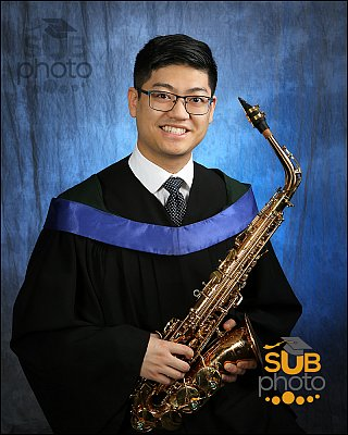 Grad with saxophone, classic collar and tie.